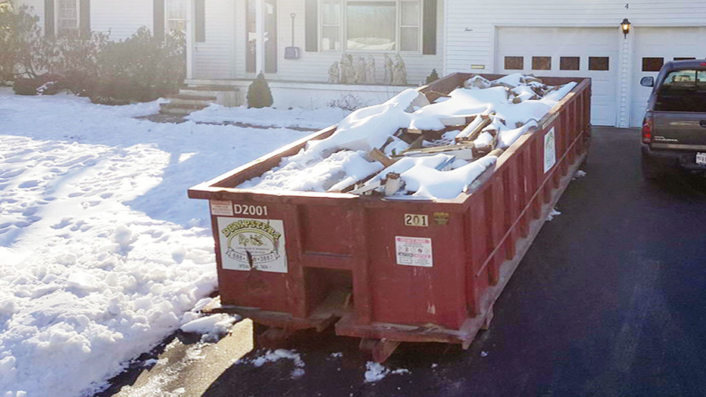 Dumpster rental in Hampton NH 03842 for deck material, kitchen cabinets, carpeting and other construction debris
